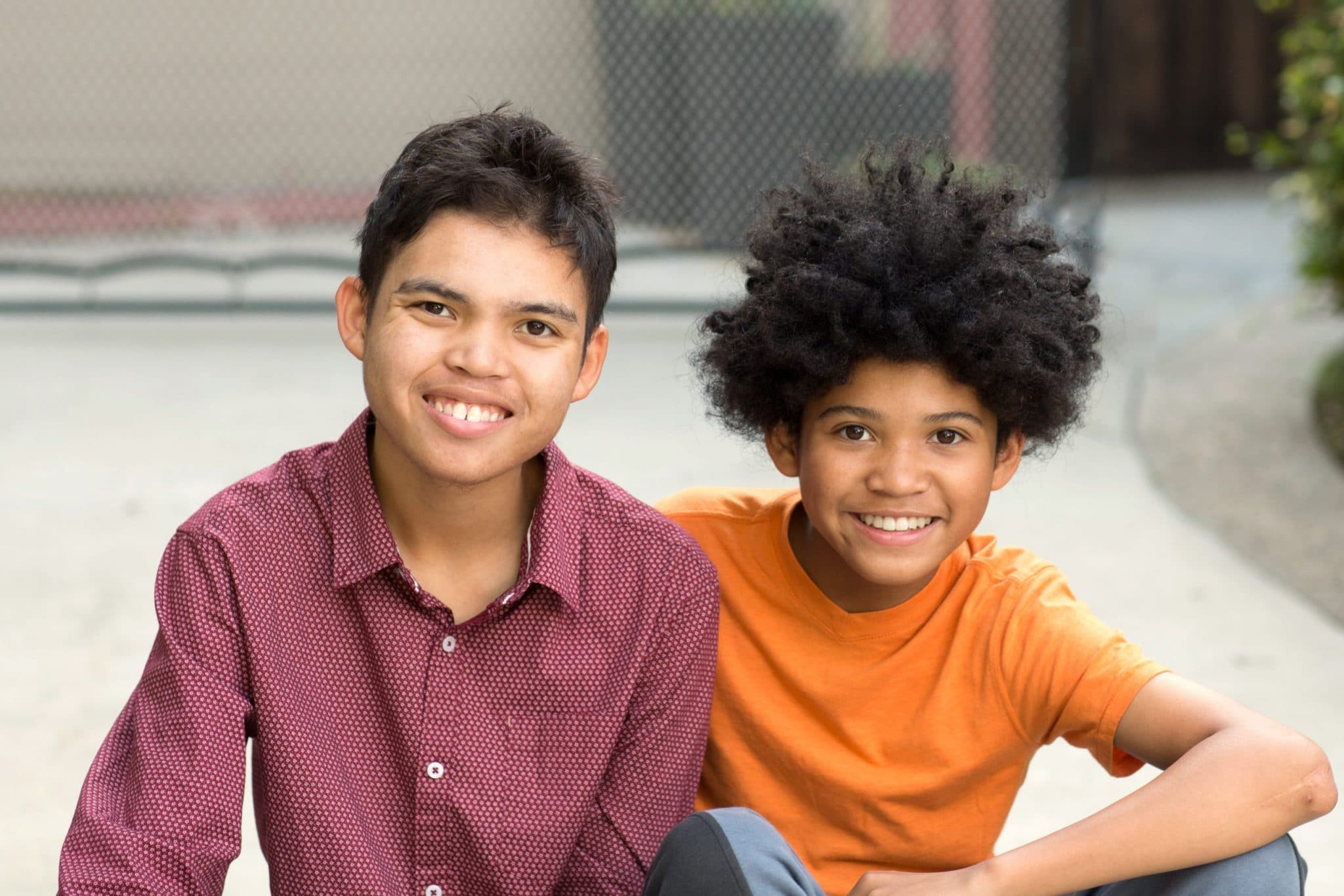 Young mixed race teenage brothers looking at the camera