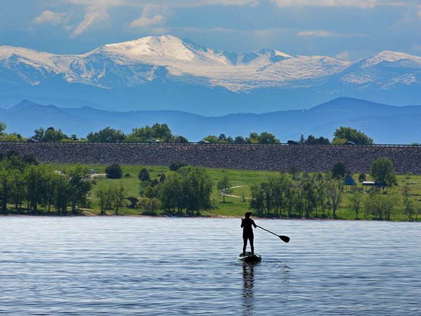 Paddle boarder on late at cherry creek state park in Aurora CO