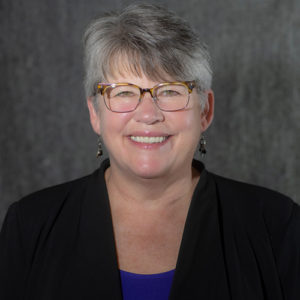 Portrait of Kathie Snell, Chief Strategy & Operations Officer of AUHMC