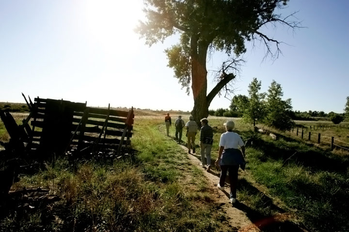Morrison Nature Center hike event with several older attendees walking in a line